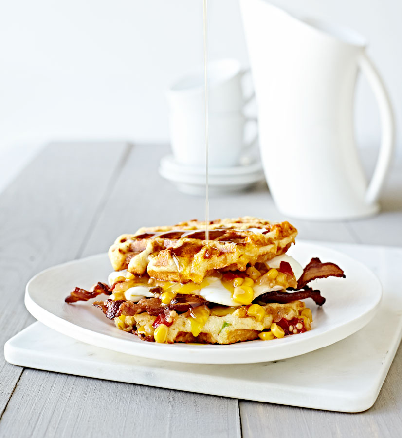 Gluten-Free Cornbread Waffle Egg Sandwich with Bacon and Maple Syrup