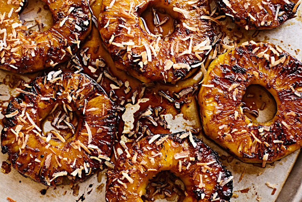 Grilled pineapple rings caramelized with piña colada glaze