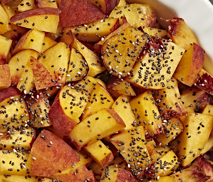 Fresh peaches sprinkled with chia seeds.