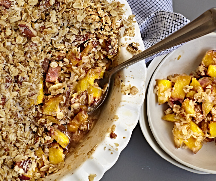 Gluten-free peach crisp with oat topping/
