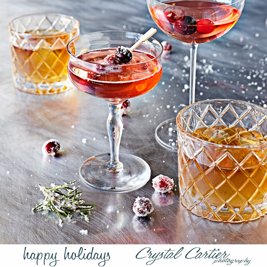 Holiday cocktails with sugared rosemary and cranberries.