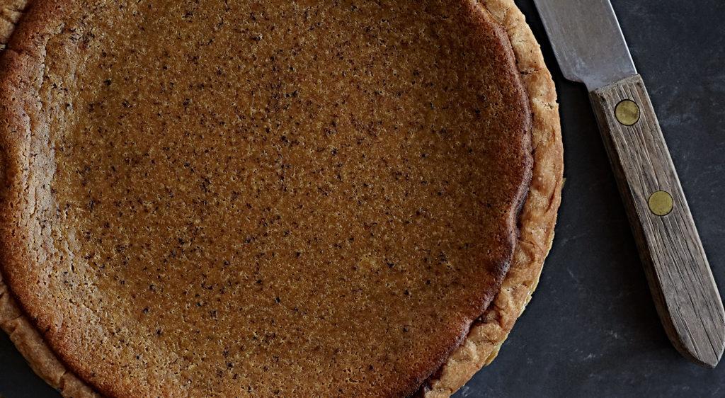 Homemade spiced pumpkin pie with gluten-free crust.