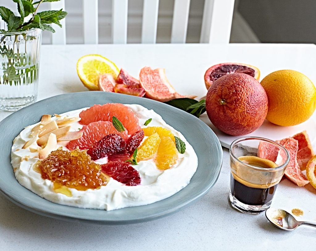 A gorgeous citrus and yogurt bowl with honeycomb, blood orange and grapefruit.