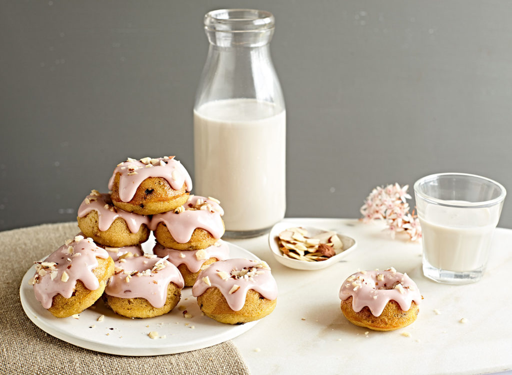 Grain-free baked mini cherry donuts with almond milk.