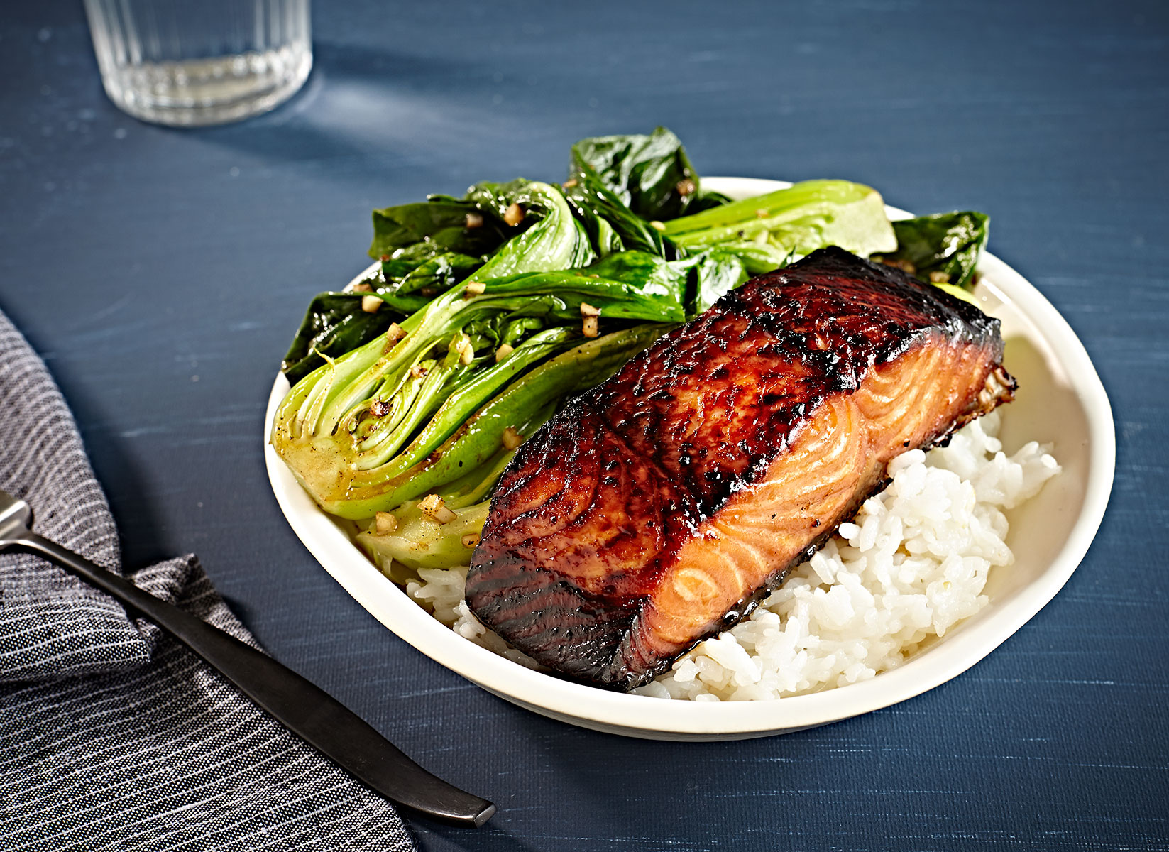 Miso charred salmon steak on sticky rice with a side of sauteed bok choy.