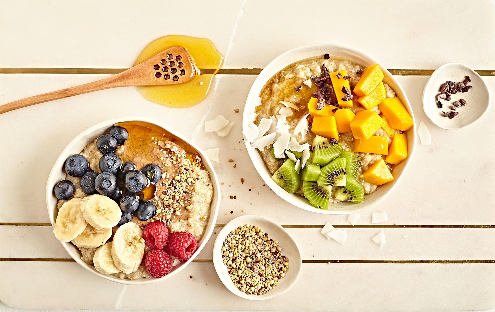 Bowls of gluten free and vegan quinoa overnight porridge with fresh toppings.
