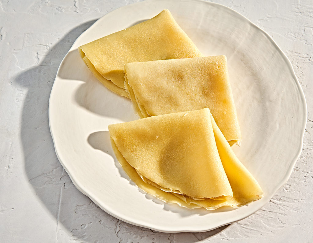 Handmade plate with gluten-free french-style crepes.