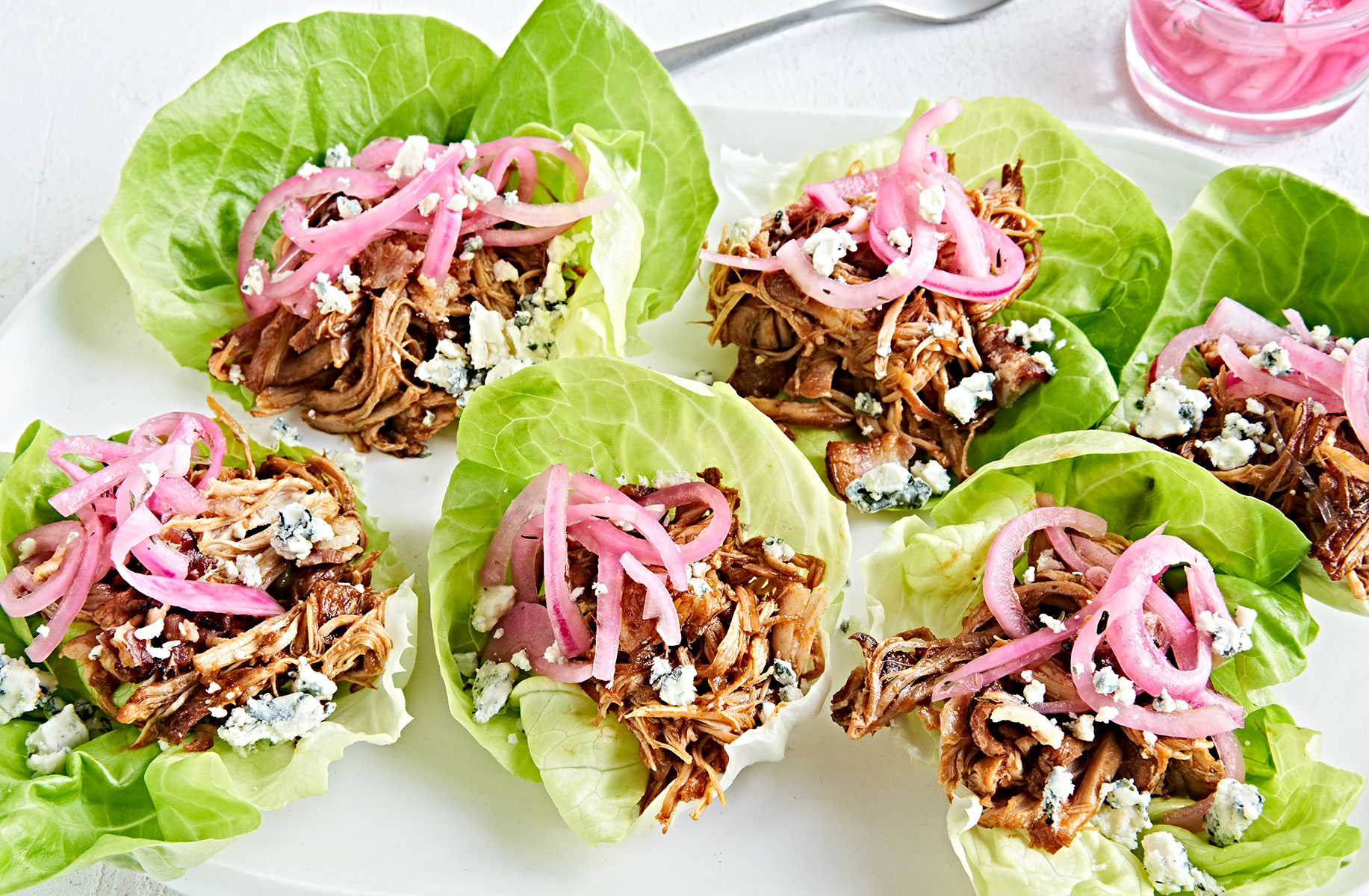 Instant Pot shredded bbq Chicken Lettuce Cups with Pickled Onions.