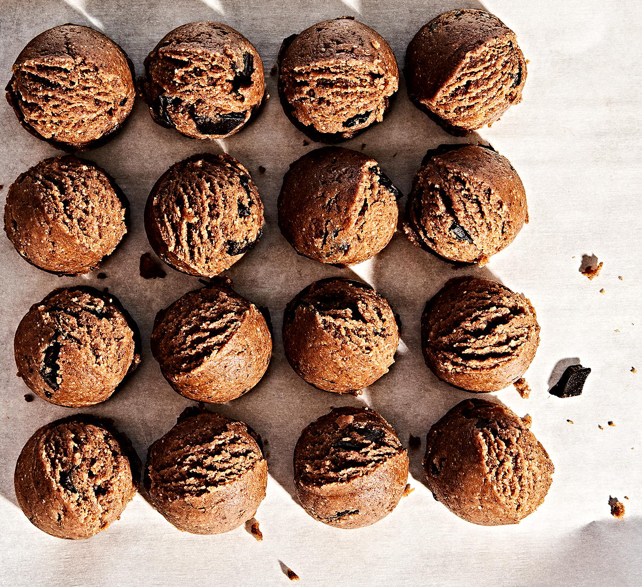 Overhead view of almond butter tahini grain-free chocolate chip cookie dough balls.