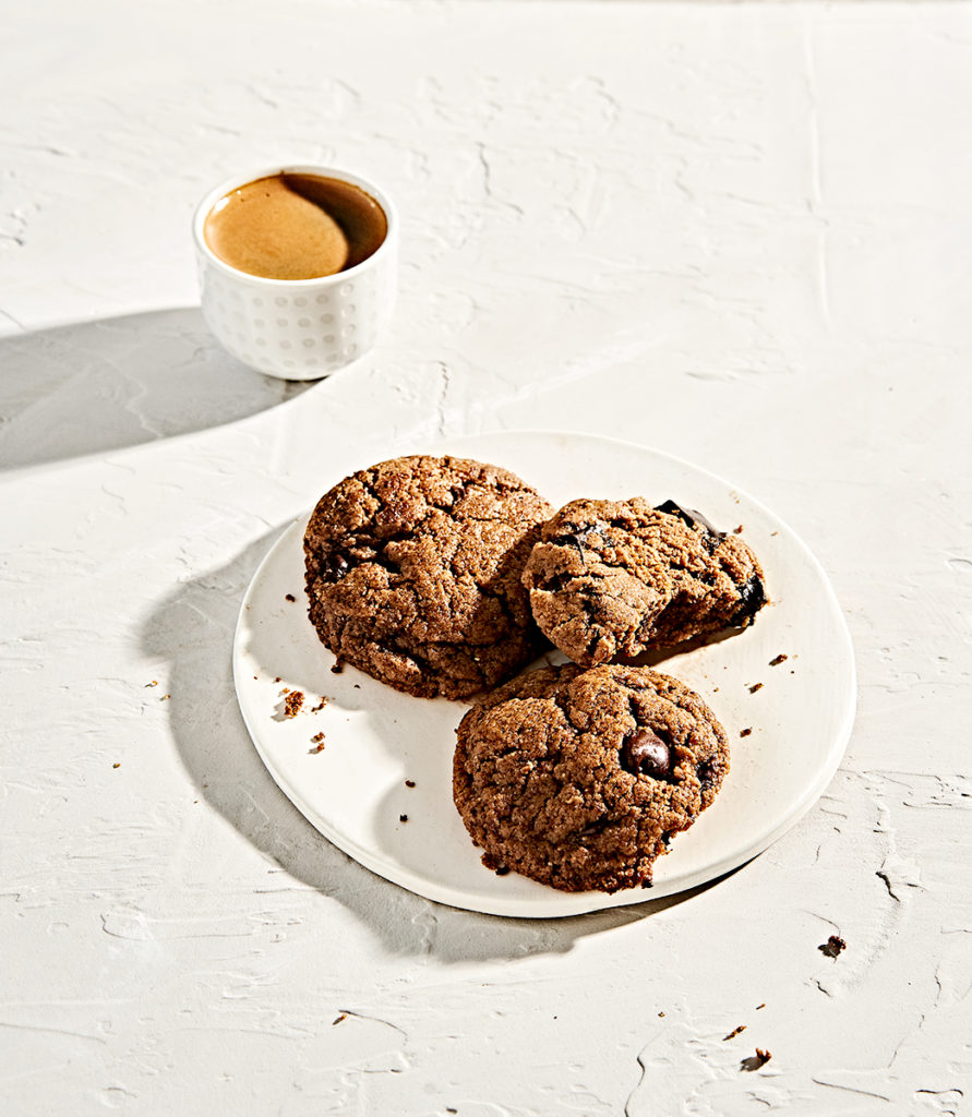 Overhead view of almond butter tahini grain-free chocolate chip cookies and espresso.