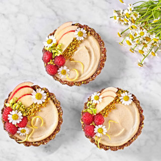No-Bake Whole30 Vegan Vanilla Tartlets with berries, apples and bee pollen.