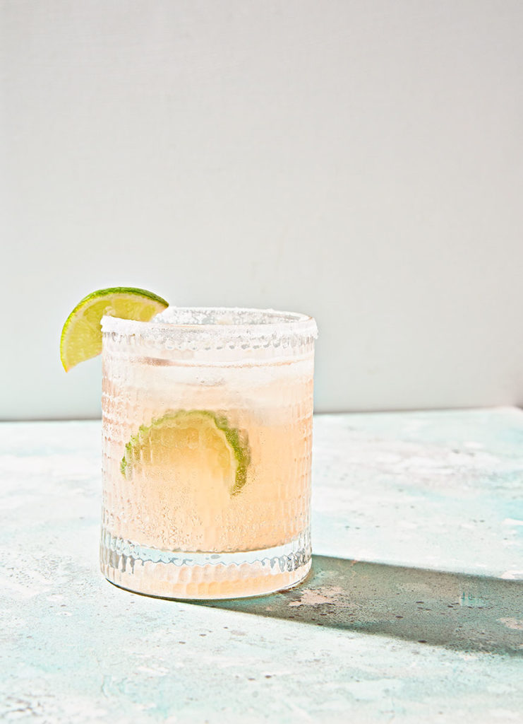 Refreshing glass of grapefruit lime paloma mexican cocktail.