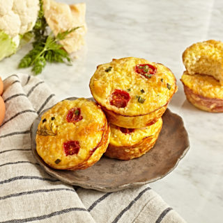 Egg bites with hidden veggies and tomatoes.