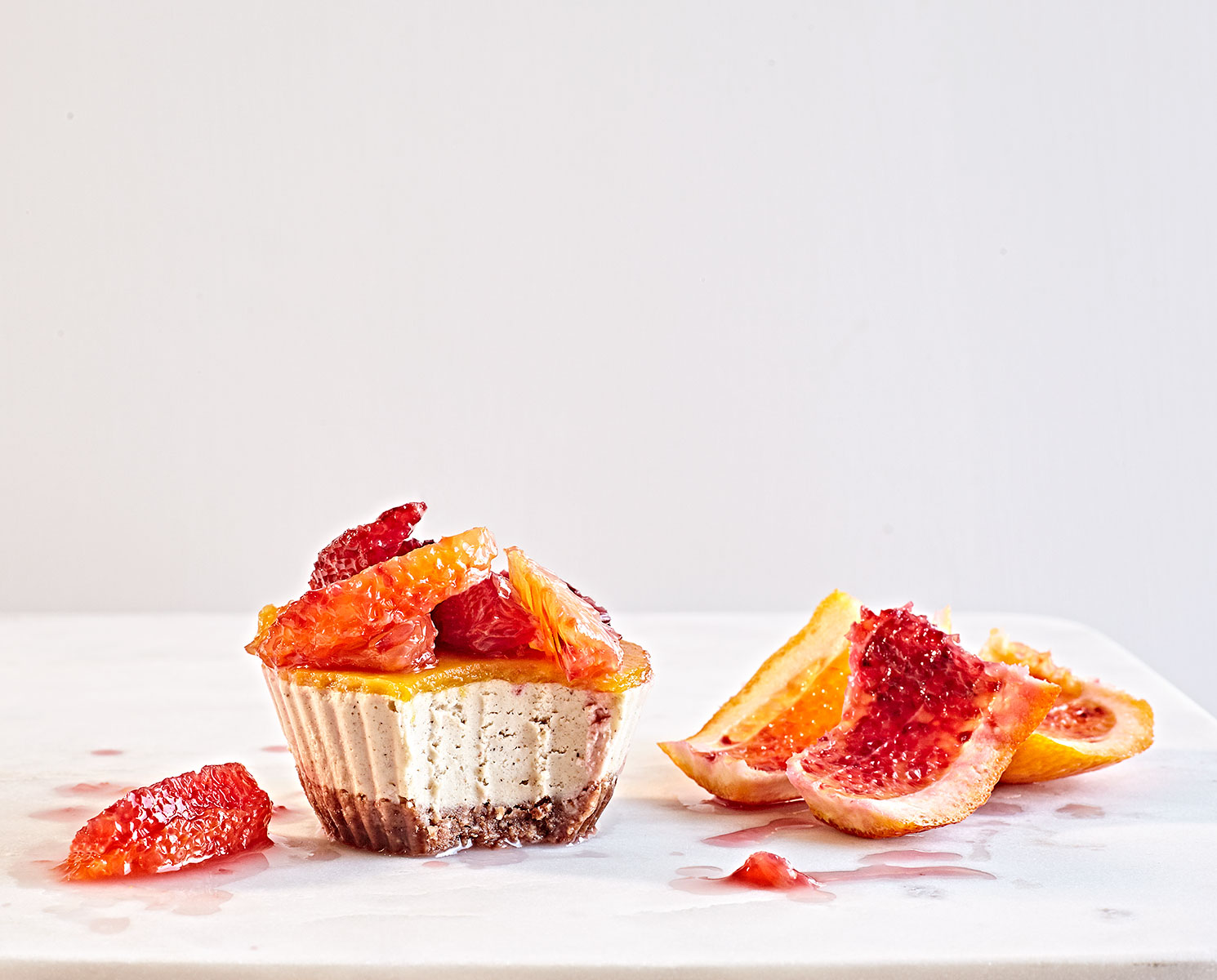 Whole30 grain-free and dairy-free vegan mini cheesecakes with blood orange segments..