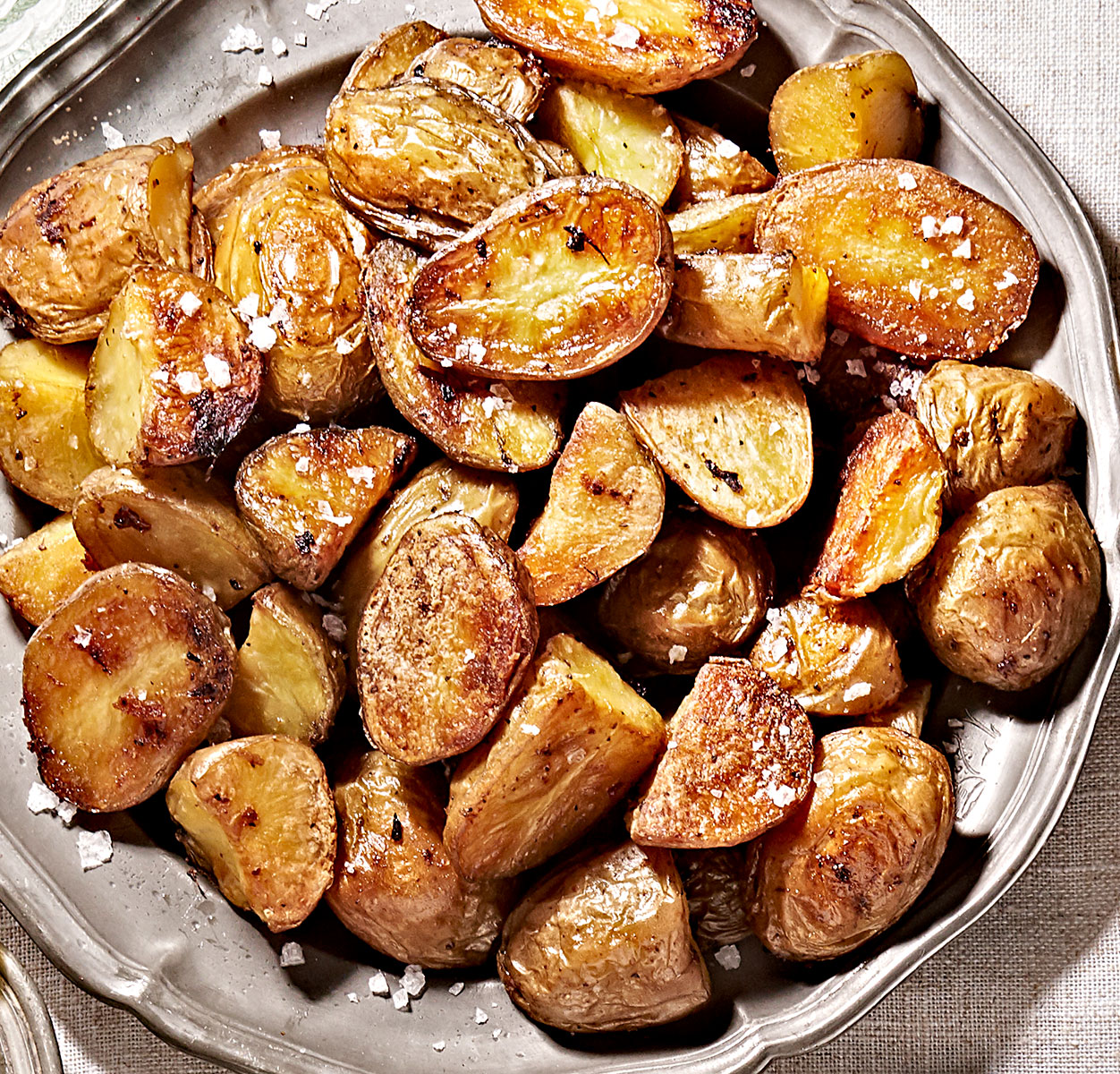 Perfect crispy roasted potatoes for every occasion on a plate.