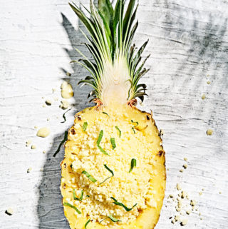 Creamy Pina Colada granita in half of a carved out pineapple.