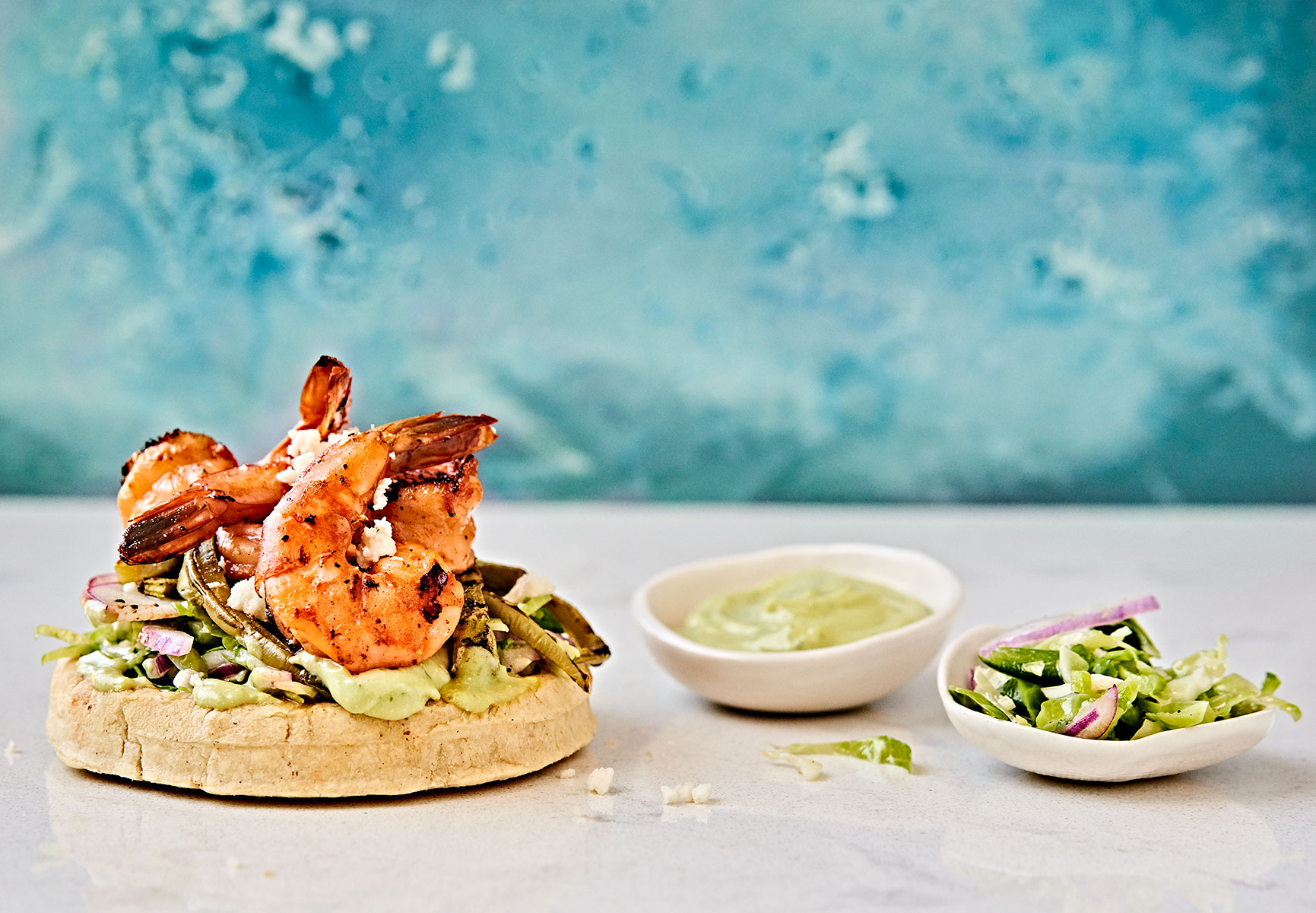 Marinated shrimp sopes mexican food on blue background.