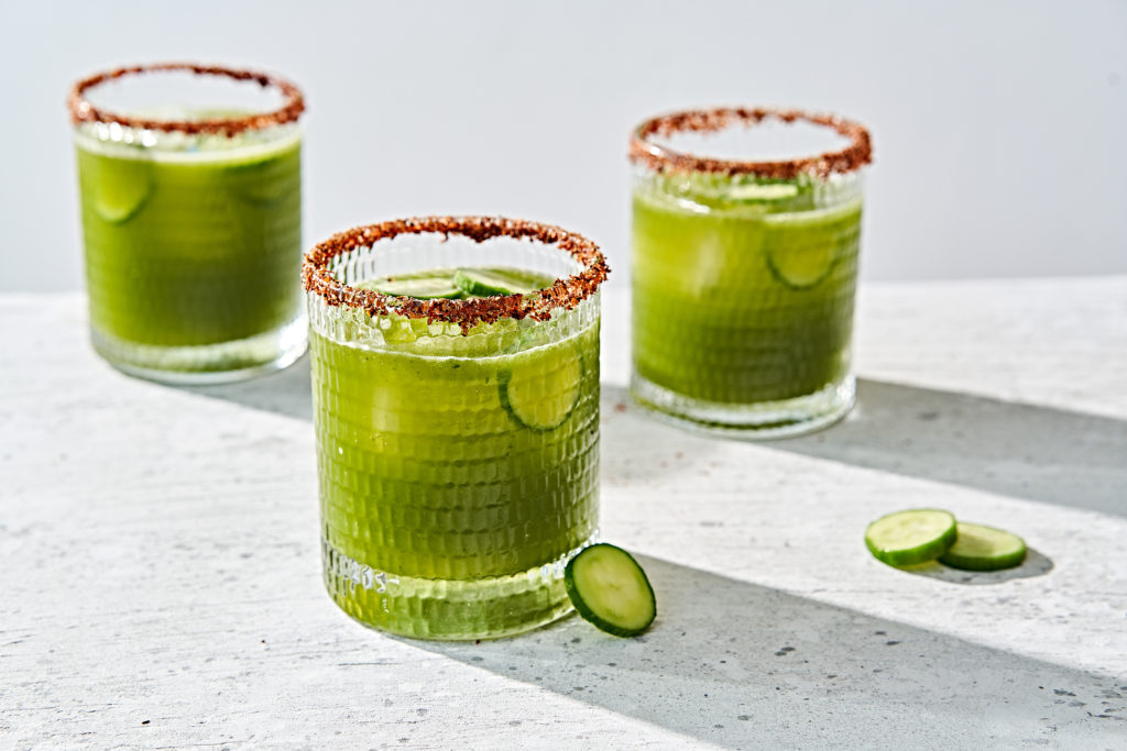 Picante spicy cucumber cilantro and lime margarita in a tajin spice rimmed glasses.
