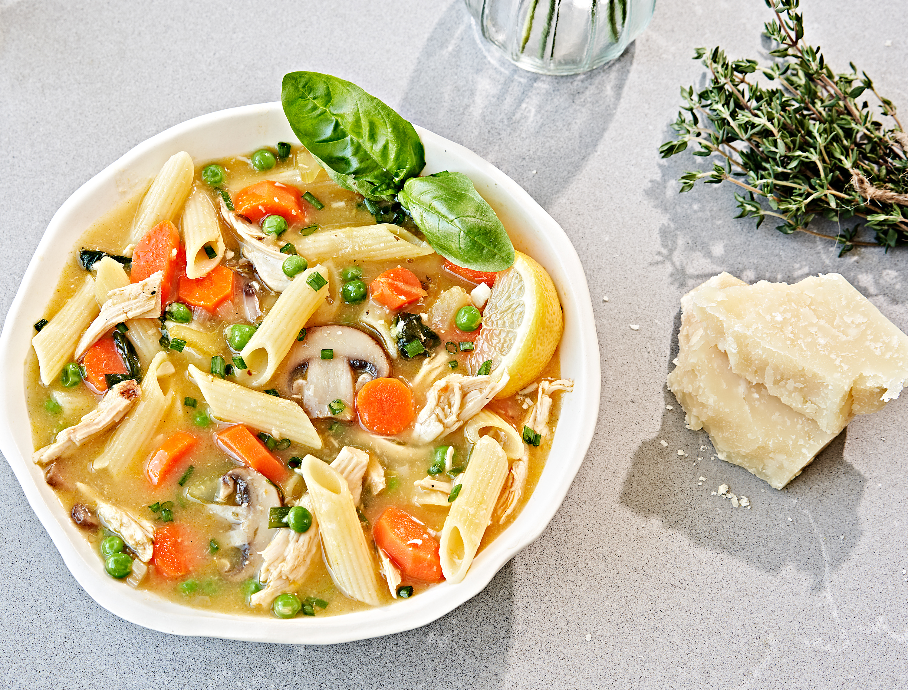 One pot lemon chicken soup with pasta in a bowl.